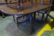 Sale 8520 - Lot 1053 - George III Mahogany Tilt Top Table with a Slightly Oval Top on a Turned Pedestal with Outswept Legs.