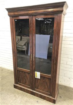 Sale 9126 - Lot 1006 - 19th Century French Flame Mahogany Bookcase, the two glass panel doors with blind lower panels & plinth base - key in office (h:191...