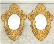 Sale 8338A - Lot 133 - A pair of gilt resin mirrored wall sconces, H 40cm