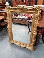 Sale 8851 - Lot 1096 - Victorian / Edwardian Cast Gilt Gesso Mirror, of serpentine form with rectangular plate