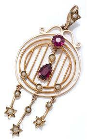 Sale 9029 - Lot 354 - AN EDWARDIAN 9CT GOLD GEMSET PENDANT; circular frame set with a round cut purple garnet and seed pearls to an articulating drop with...