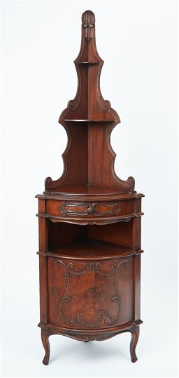 Sale 9102 - Lot 1088 - An antique French walnut corner cabinet C: 1910. The carved and shaped back fitted with 2 shaped shelves above the scroll carved fri...