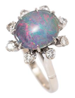 Sale 9164J - Lot 499 - A RETRO 18CT WHITE GOLD OPAL AND DIAMOND RING;  high basket set with an oval opal triplet and surround of 8 round brilliant cut diam...