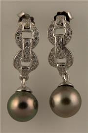 Sale 8060B - Lot 304 - A PAIR OF TAHITIAN PEARL STUD EARRINGS; 8.5mm round pearls to zirconia set sterling silver mounts