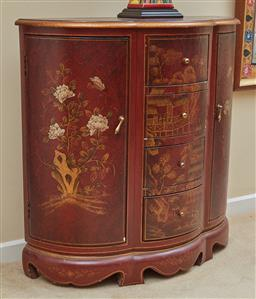 Sale 9097H - Lot 41 - An oriental cabinet of trefoil design, depiction peonies and figures in a landscape, presenting four central drawers flanked by two...