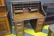 Sale 8255 - Lot 1089 - American Oak Roll -Top Desk, with pigeon-holes, on two pedestal fitted with eight drawers (key in office)