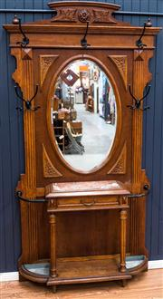 Sale 8287A - Lot 5 - An impressive French Walnut hallstand with rouge marble top, circa 1920, featuring original hand forged iron hooks & umbrella mounts...
