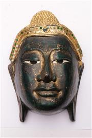 Sale 9070 - Lot 86 - A Carved and Gilded Mask (L 30cm)