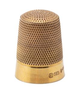 Sale 9186 - Lot 348 - A VINTAGE 9CT GOLD HALLMARKED THIMBLE; Chester 1926, size 5,  24mm x 14mm, wt. 4.74g.