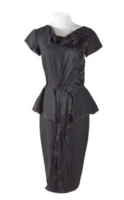 Sale 8493A - Lot 23 - A couture Karl Kapp black ruffle dress with peplum detail, Aus size 6