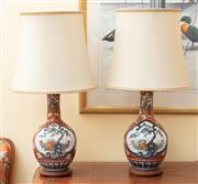 Sale 9055H - Lot 25 - A pair of Chinese imari palette baluster lamps on timber bases with cream silk shades. H:88cm