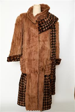 Sale 9095F - Lot 8 - A heavy Yves et Alain Salomon brown long vintage fur with pattern trim around arms and lower section of the coat, Made in France, si...