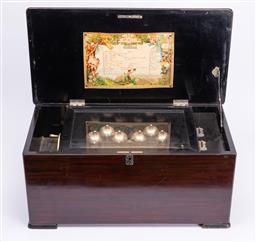 Sale 9185E - Lot 12 - A Victorian walnut floral inlaid music box with label for 10 melodies, some loss, Height 27cm x Width 59cm x Depth 31cm, untested