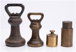 Sale 9185E - Lot 130 - A group of four weights, tallest Height 18cm
