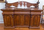 Sale 8530A - Lot 63 - An antique English flamed mahogany inverted breakfront 4 door sideboard C: 1875. The arched scroll carved back above the inverted br...