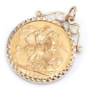 Sale 9029 - Lot 365 - AN 1899 SOVEREIGN PENDANT; English sovereign set in a 9ct gold frame, wt. 8.86g.