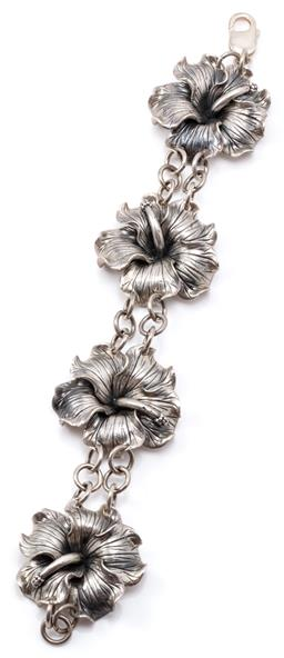 Sale 9132 - Lot 323 - A SILVER FLORAL BRACELET; composed of 4 hibiscus blooms united by 2 rows of belcher links to a parrot clasp width 40mm, length 22cm,...