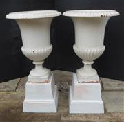 Sale 8256A - Lot 22 - A pair of  painted white Antique French cast iron garden urns on stands (four pieces. Overall Ht: 86 x 46 cm