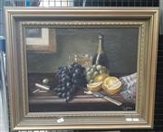 Sale 9065 - Lot 2005 - Ed Ashley Champagne, Citrus, Grapes and Cigarette, 1900 oil on canvas, 50 x 60cm (frame) signed and dated lower right