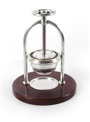 Sale 8224A - Lot 79 - A rare Vintage French silver plate fruit press on timber stand, 30 x 20 cm