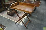 Sale 8359 - Lot 1072 - A Victorian Mahogany Butlers Tray with pierced handles and folding stand.