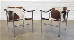 Sale 9188 - Lot 1085 - Pair of LC1 armchairs with cow hide upholstery (h:65 x w:60 x d:64cm)