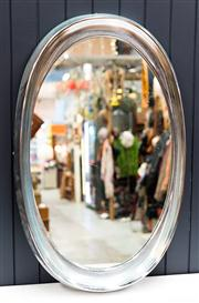 Sale 8287A - Lot 10 - An oval Retro style chrome plated mirror, 70cm high x 40cm wide