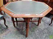 Sale 8485 - Lot 1028 - Late 19th Century Cedar Octagonal Games Table, with green leather top & turned legs joined by stretchers