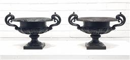 Sale 9126 - Lot 1105 - Pair Of Cast Iron Urns, with scrolled handles, the lower body reeded & on raised on square feet (one with missing section to rim, H:...