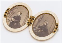 Sale 9180E - Lot 95 - A Victorian oval ivory compact photo locket with two portraits, Length 7cm, crack to glass