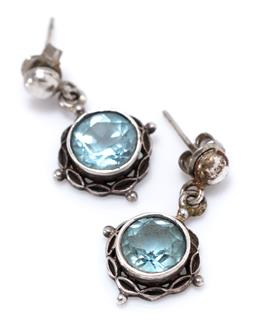 Sale 9213 - Lot 373 - A PAIR OF SILVER TOPAZ STUD EARRINGS; each set with an approx. 3.5ct round cut blue topaz suspended from a bead set post, length 25m...