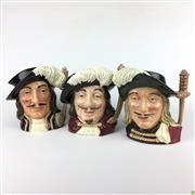 Sale 8562R - Lot 247 - Royal Doulton Toby Jugs depicting the Three Musketeers; Athos, Portos and Aramis (H: 19cm)