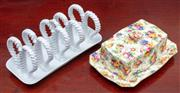 Sale 9058H - Lot 48 - A Royal Winton Grimwades lidded butter dish in the chintz pattern together with an unusual white glazed ceramic toast rack, Larger l...