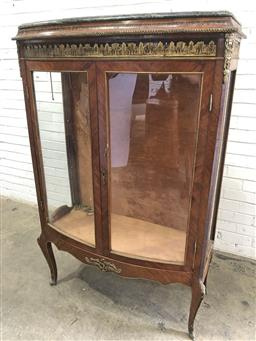 Sale 9126 - Lot 1173 - Transitional Style Bow Front Display Cabinet, with green stone top & classical style brass mounts, with two glass panel doors & cabr...