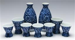 Sale 9156 - Lot 99 - A Japanese porcelain sake set, with four single and two double shot cups, H12cm (largest)
