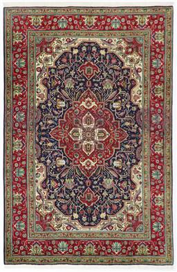 Sale 9181C - Lot 32 - A navy field and red border Tabriz north Persian city rug c1970 in excellent condition 315 x 200cm