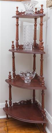 Sale 8530A - Lot 43 - A mahogany corner display stand. The 4 graduated shelves with pierced foliate carved backs, raised on tapering turned columns, H 140...