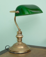 Sale 8795A - Lot 64 - A brass bankers lamp with a green glass shade