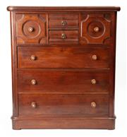 Sale 8960J - Lot 37 - An Australian Colonial cedar 7 drawer chest C: 1875. The ovolu cross banded top edge above twin centre brass handled drawers flanked...