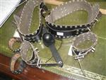 Sale 7926A - Lot 1653 - Leather bondage pieces including leg and arm accessories and gag