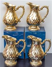 Sale 8279A - Lot 55 - A set of four gilt Royal Chelsea Sheffield fancy water jugs, height 21cm