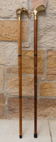 Sale 8677B - Lot 506 - Two collapsible walking sticks, one with elephant head handle, the other with golf club head, taller 93cm