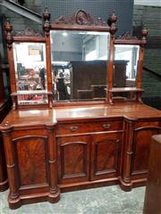 Sale 8956 - Lot 1064 - Victorian Mahogany Breakfront Sideboard, the stepped mirror back with shelves, above a central drawer & two panel doors, flanked by...