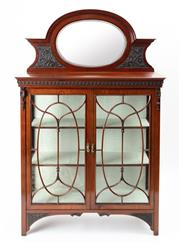 Sale 8960J - Lot 38 - A superior quality elegant antique English mahogany Edwardian display cabinet by James Phillips and Sons C: 1905. The oval framed mi...