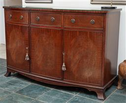 Sale 9097H - Lot 51 - A mahogany veneered bowfront sideboard with three drawers and three doors on bracket feet, Height 92cm x Width 138cm x Depth 55cm