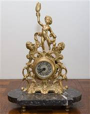 Sale 8338A - Lot 128 - A Blessing brass clock with quartz movement on black marble base, H 38cm