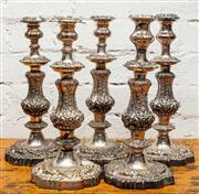 Sale 8942H - Lot 87 - A set of five heavily embossed candlesticks of baluster form, Height 35cm