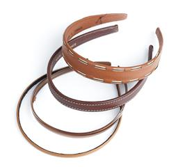 Sale 9091F - Lot 250 - A COLLECTION OF FOUR THIN HEADBANDS; in leather, inclding a Cherry Chau example