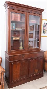 Sale 8530A - Lot 98 - A tall antique English mahogany 2 part bookcase C: 1865. This well proportioned bookcase has a stepped cornice above 2 glazed doors...
