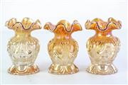 Sale 8957C - Lot 625 - Set of three amber carnival glass bud vases (H11cm, chips and losses to base)